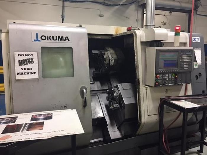 Okuma OSP P200L Control Variable LU300 Big Bore Turning Center with Twin Turrets 2 Axis