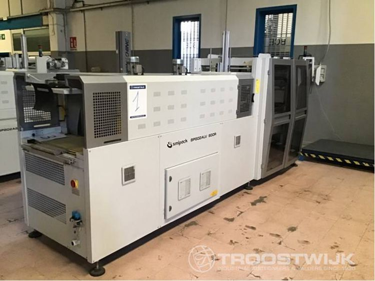Shrink wrapping and labelling machines