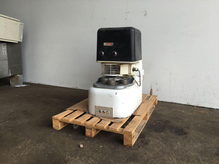 Crypto, Peerless Omatic minor rotary pie block machine