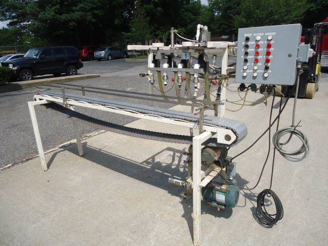 Others 4 SPOUT, STRAIGHT LINE AUTOMATIC PRESSURE GRAVITY LIQUID FILLING MACHINE