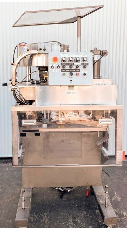 Kaps-All FS-B Six Spindle Capper and Elevator