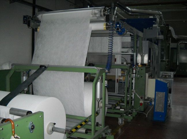 Bonino, Traversi & Armenti Complete line opening carding and web forming for filling