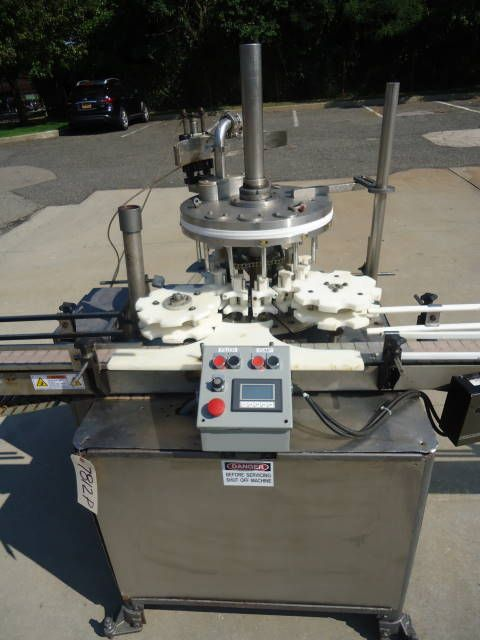 MRM Versafil, Twelve Spout Rotary Positive Displacement Filler With Conveyor