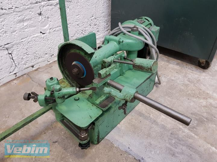 Grinding machine for band saws