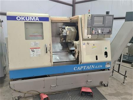 Okuma OSP-E100L w/ IGF Conversational 4500 rpm Captain L370 Big Bore 2 Axis