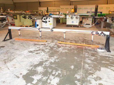 Pneumatic clamp for a two-section format saw