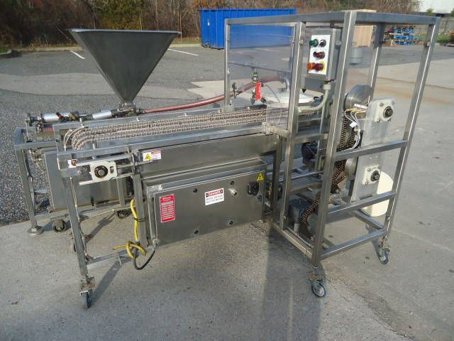 Raque SAUCE DEPOSITING SYSTEM FOR FROZEN PIZZA SAUCE DEPOSITING SYSTEM FOR FROZEN PIZZA