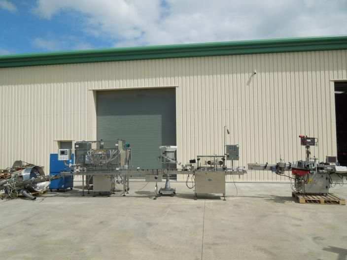 King automatic liquid filling/capping and labelling