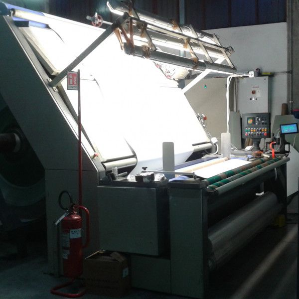 Inspection table with wrapping device