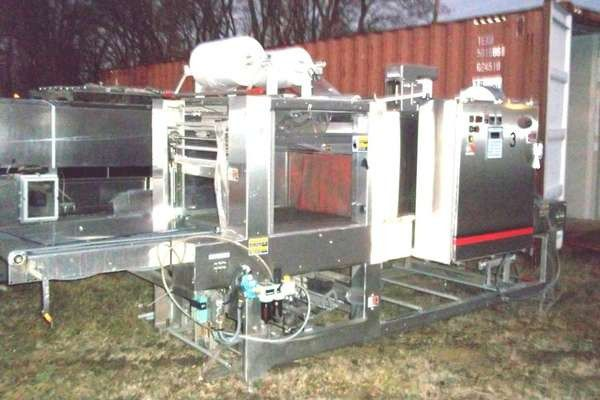 Delkor SPOT PAK PLASTIC CONTAINER COLLATING & PACKAGING LINE