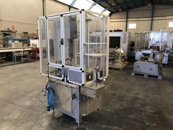 93044 Ultrasonic filling and sealing machine for bottles