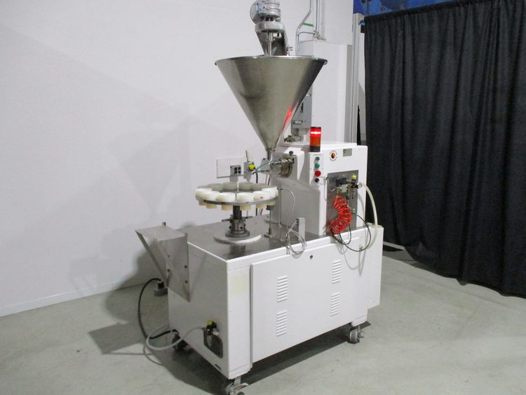 Unipac Combimatic, rotary jar filler