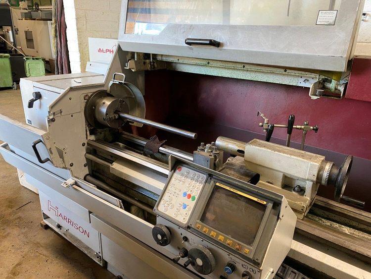 Harrison Fanuc control 2500 rpm Alpha 400 Plus CNC/Manual Teach Lathe 2 Axis