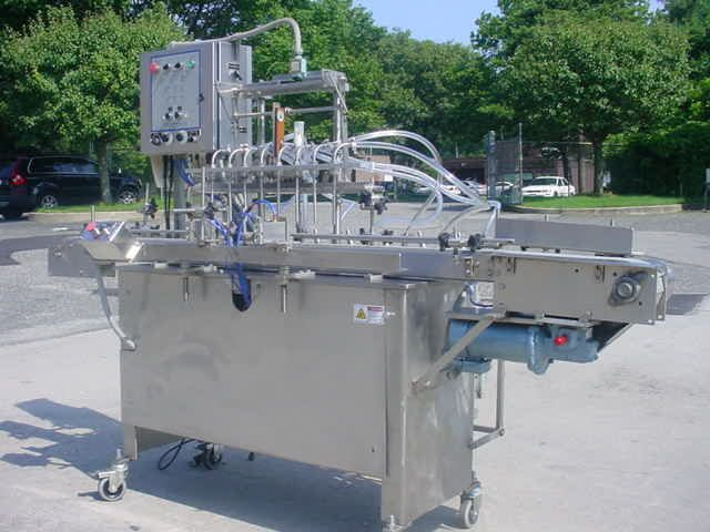 Filling Equipment EIGHT PISTON STAINLESS STEEL AUTOMATIC FILLING MACHINE.