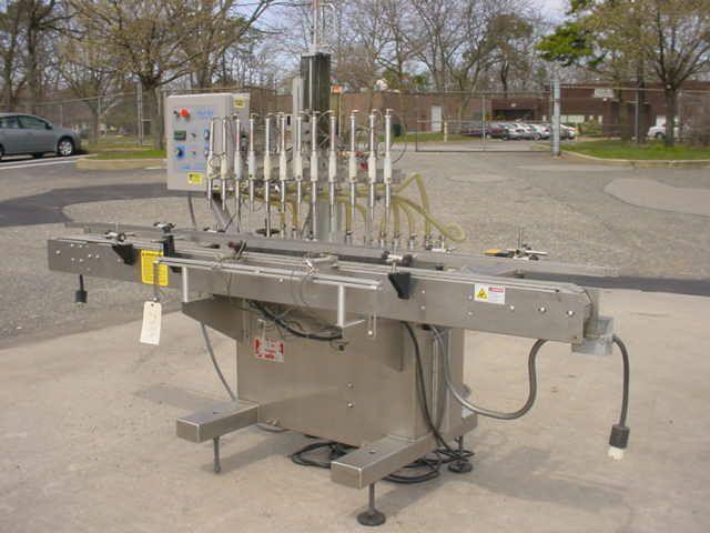 Kaps-All VOL-32 AUTOMATIC TWELVE PISTON STAINLESS STEEL INLINE FILLING MACHINE,
