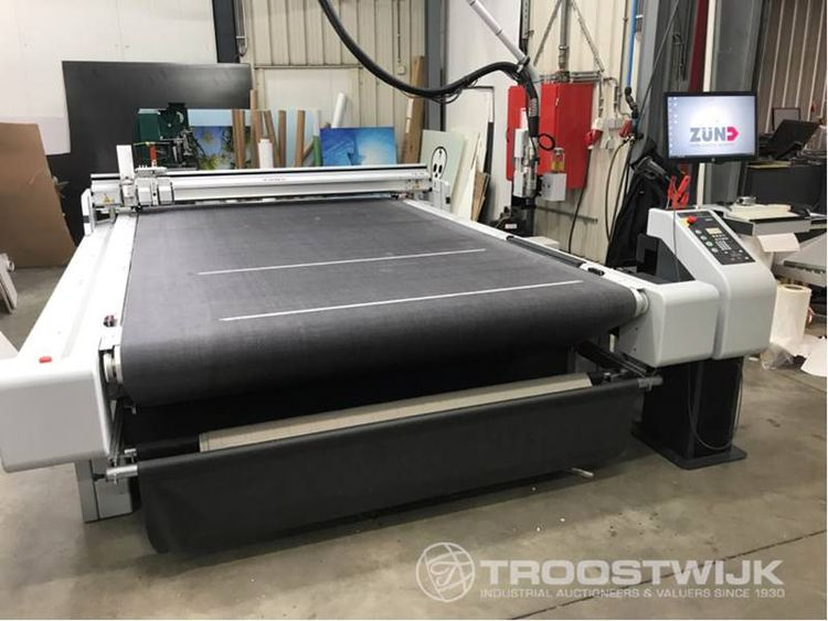 Online auction of recent Océ Canon flatbed printer, Zünd cutting plotter and CP bourg booklet due to bankruptcy